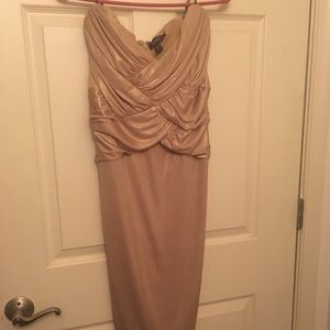 Bebe Gold shimmery ruched strapless dress.